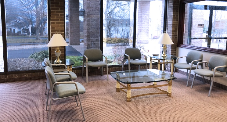 waiting area in Eyecare Center with glass tables